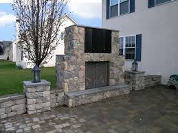 an outdoor ventless gas fireplace with an outdoor tv cabinet is a great addition to this