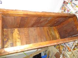 Making a wooden blanket box out of pallets and adding some stain to the wood  - YouTube