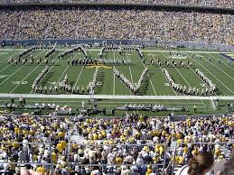 in the middle of the show the band plays two of the most iconic tunes ever to grace the wvu band se simple gifts and country roads