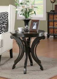 round end table with animal print top scrolled base