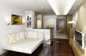 studio apt furniture ideas. Wonderful Studio Apartment Have White Beds And Pillows Small Glass Table In Front Led Screen Tv Bar Chair Also Lamps Around Room Apt Furniture Ideas E