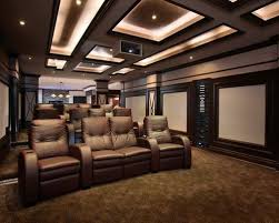movie theater living room. example of a transitional enclosed home theater design in toronto with projector screen movie living room