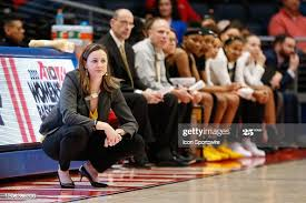 Rams head coach Beth O'Boyle watches the action on the court ...