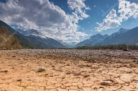 Dry cracked earth ground with stones in mountain land at blue sky ⬇ Stock Photo, Image by © a4ndreas #106251416
