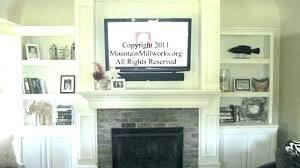 hanging tv above fireplace mounting a above a fireplace hang above