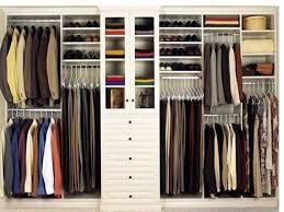closet design with white closet system and beige rug