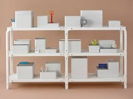 storage containers stacked on a magis steelwood modular shelving system