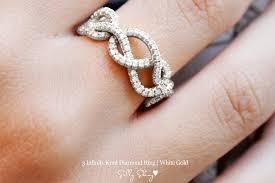 infinity diamond wedding band. unique wedding band with three diamond infinity hearts