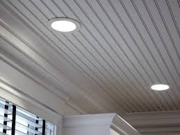 white beadboard ceiling with recessed lighting