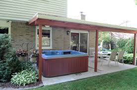 20 x 12 cement patio with 4 person sun marin hot tub with insulated cover