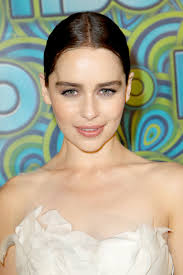 emilia clarke opted for a sleek middle parted updo that she accented with subtle makeup