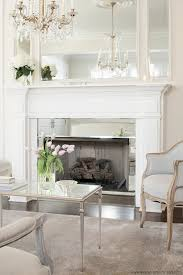 i love the mirror around the fireplace leo designs chicago living rooms french living room inset mirror fireplace mirror mirror fireplace surround