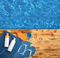 pool water background. Summer Beach Set On Swimming Pool Water Background \u2014 Stock Photo