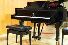 Grand Piano Music Light Concert Grand Piano And Regulated Black Bench In Light Hall