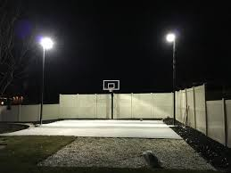outdoor basketball court with 20 11 gauge rab poles and 400 mega flood rab lights