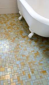 vintage bathroom with claw foot tub subway tile backsplash and gold and blue mosaic glass tiles floor