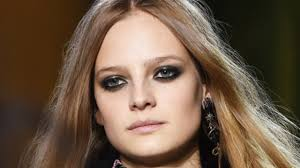 model with smoky eye shadow blue eyes and light brown hair
