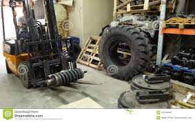 Forklift Driver In Protective Vest Driving Forklift At Warehouse Of