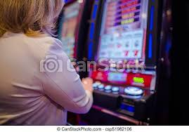 Woman playing in the casino. Caucasian woman playing video games in the las  vegas casino. video slot machines. | CanStock
