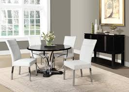 circle black wooden table with silver steel curving legs combined with white leather chairs and silver