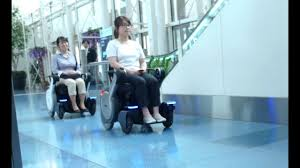 robotic electric wheelchair whill next linkray signage hospitality solutions at haneda airport