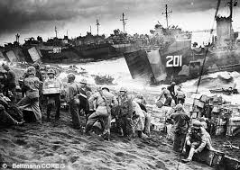 「On February 23, 1945, during the bloody Battle for Iwo Jima, U.S. Marines take Mount Suribachi and raise the U.S. flag.」の画像検索結果