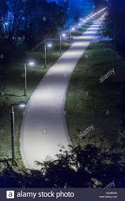 Along The Lighted Path Lighted Path In A Garden In The City At Night Stock Photo