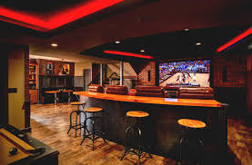 small basement corner bar ideas. Interior Design:Large Screen And Lamps On The Cream Wall Bined With Dark Brown As Small Basement Corner Bar Ideas