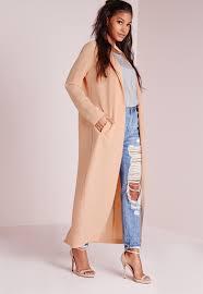 Nicki Minaj flashes cleavage wearing a silk dressing gown in a.