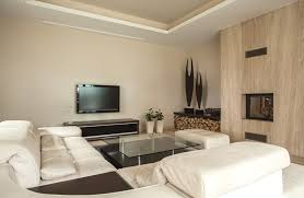 white furniture in living room with tray ceiling