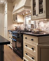 Love this kitchen. especially the hardware and subway tile back splash. not black  appliances, stove.