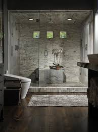 It's like showering in a jungle spa. Unique rock-like features and tiles  accentuate the frameless shower.
