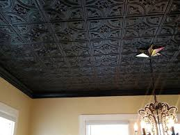 black ceiling tiles add drama to the