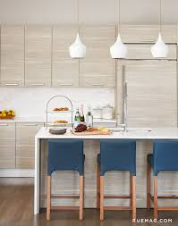 Sleek Kitchen With Blue Leather Bar Stools And White Pendant Lights R63
