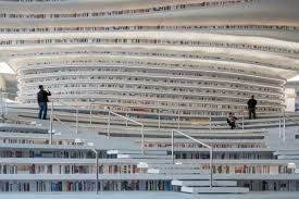 The five-story, 360,000-square-foot library features shelves spanning from  the floor to ceiling  many of the shelves double as stairs and seats in  the ...