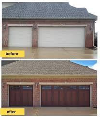 clopay faux wood garage doors. this homeowner replaced traditional raised panel steel doors with a more\u2026 find pin and more on clopay faux wood garage