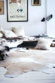 faux cow skin rug white walls cowhide rug fur pillows fake animal skin rugs with head