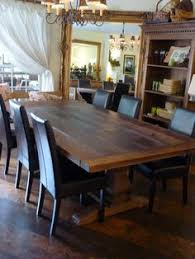 rustic dining room design with rectangular dark brown rustic pine dining table black iron chandelier and black leather dining chair charming