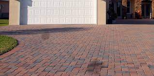 remove oil stains from drive ways