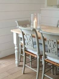 pastel dining room chairs with a white table