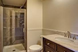 bathroom chair molding. traditional 3/4 bathroom with complex marble counters, marble, inviting home, chair molding