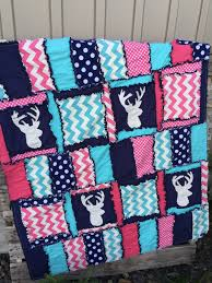 a the hot pink turquoise and aqua deer quilt for woodland baby bedding