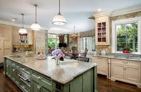 country kitchen with green island with contrasting cream color cabinets