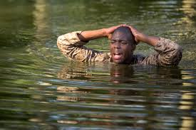 u s department of defense photo essay marine recruit giovani d henry walks through a pond after falling from an obstacle during
