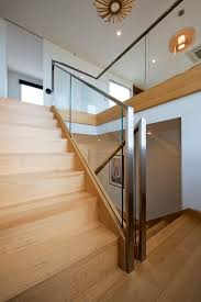 How To Hardwood Stairs Glass And Wood Stair Railing Pinteres