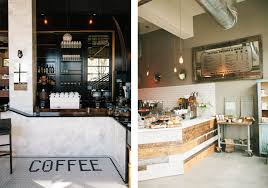 The coffee shop on the left is embellished with black-coated walls and  built-