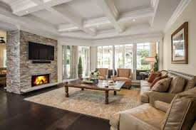 miami stacked stone fireplace living room traditional with earth tones clear shade recessed lights