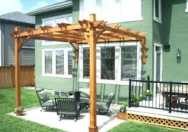 building a pergola attached to house oak polished finish wooden posts crossbeams rafters roof battens ledger