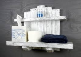 white bathroom shelves over toilet