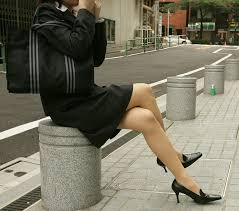 Nude women in business suits